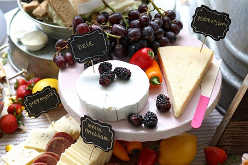 A Healthy Snack With Lots Of Yogurts, Cheese, And Nuts