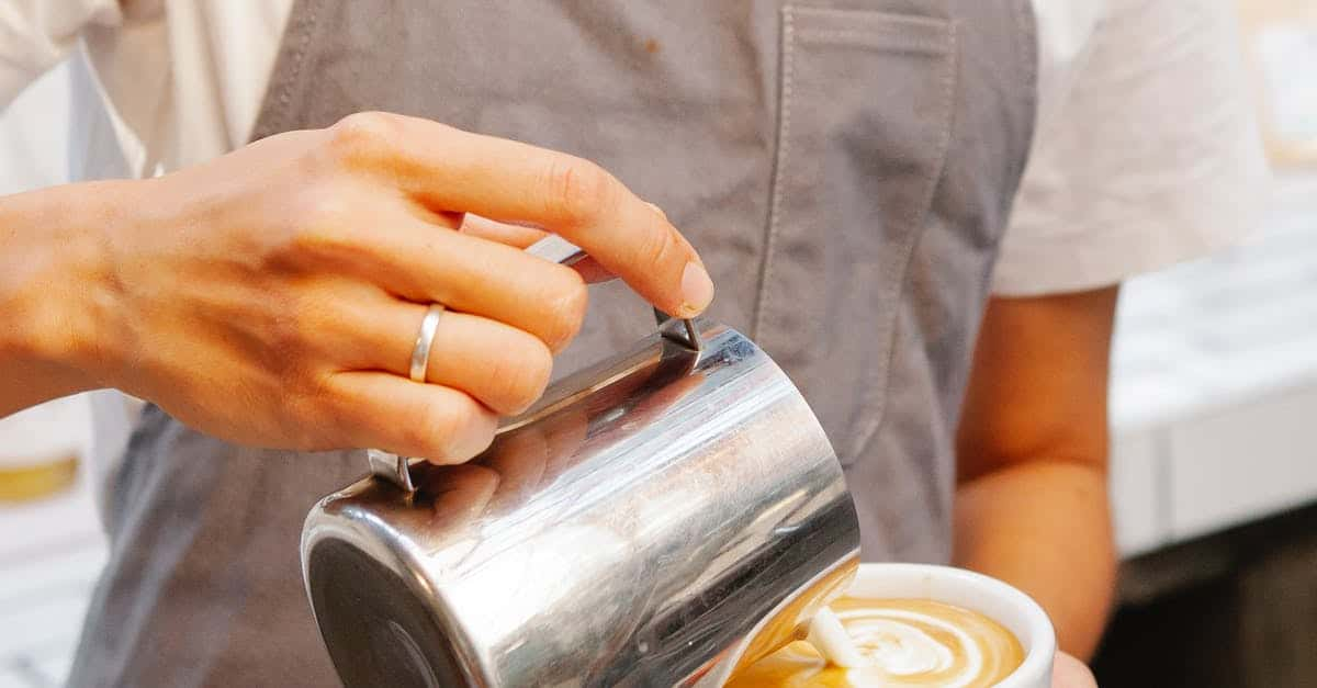 A hand holding a cup